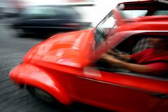 man driving fast - stock photo