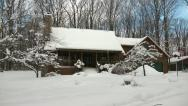 Stock Video Footage of Snow-Covered Home in the Woods