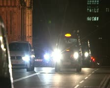 London Parliament and Big Ben with traffic at night Stock Footage
