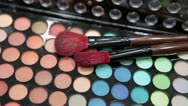 Stock Video Footage of Brushes for make-up applaying on the colorful palette
