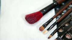 Make-up tools brushes with color cosmetic palette - stock footage
