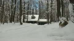 Pan to House in Snowy Woods Stock Footage