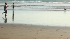 Jogging on the beach Stock Footage