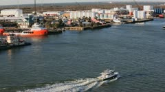 Tour Boat passes pilot boat Stock Footage