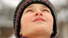 Boy looking to the sky in winter, close-up Stock Footage