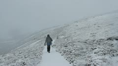 Male hiker walking in Cairngorm national park in winter Scotland Stock Footage