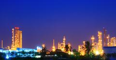 Column tower in petrochemical plant at twilight Stock Photos