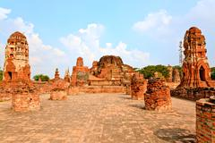 main pagoda in ruins wat mahathat - stock photo
