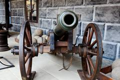 Old cannon and cannonballs Stock Photos