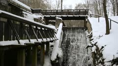 Old water mill house creek flow cascade snow winter Stock Footage
