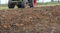 Tractor machine closeup plow trench furrow agriculture field Stock Footage