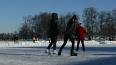 Active people leisure winter sport skate slide ice frozen lake Stock Footage