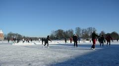 People winter sport skate ice frozen lake castle fort trakai Stock Footage