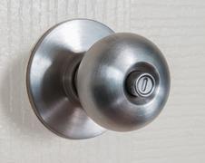 close up shot of stainless steel round ball door knob - stock photo