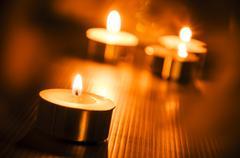 Burning candle light background Stock Photos
