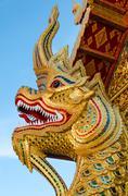 Golden serpent statue head Stock Photos