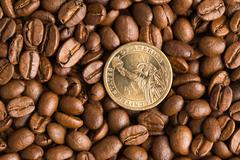 coin on coffee beans background - stock photo