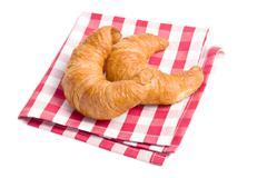 fresh croissants on checkered napkin - stock photo