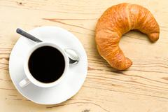 fresh croissant with coffee - stock photo