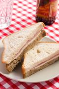 Stock Photo of ham sandwich on checkered tablecloth
