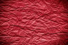 Stock Photo of red crumpled paper background