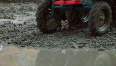 Tractor race through the mud Stock Footage