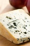 blue cheese on kitchen table - stock photo