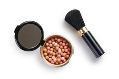 bronzing pearls and makeup brush - stock photo