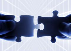 hands trying to fit two puzzle pieces together - stock illustration