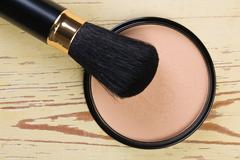 makeup brush and cosmetic powder compact - stock photo