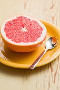 Sliced red grapefruit Stock Photos