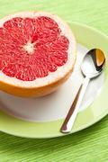 Sliced red grapefruit Stock Photos