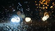 Stock Video Footage of Night road, rain on windshield, bokeh 030