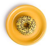 sweet doughnut on yellow plate - stock photo