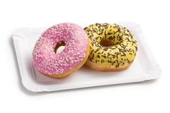 sweet doughnuts on paper plate - stock photo