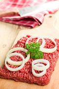 Raw minced meat on kitchen table Stock Photos