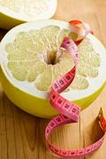 dieting . pomelo fruit - stock photo