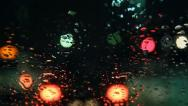 Stock Video Footage of Night road, rain on windshield, bokeh 034