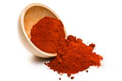 paprika powder in wooden bowl - stock photo