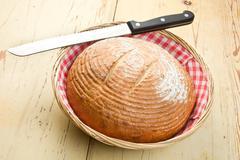 Round bread on kitchen table Stock Photos