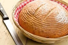 Stock Photo of round bread on kitchen table