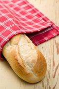 french baguette on wooden table - stock photo