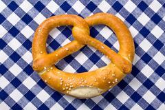 pretzel on checkered napkin - stock photo
