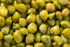 Green capers background Stock Photos