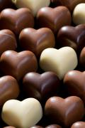chocolate hearts background - stock photo