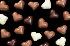 chocolate hearts on black - stock photo