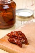 dried tomatoes on kitchen table - stock photo