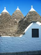 traditional houses in puglia, italy - stock photo