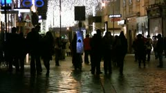 Pedestrians walking on a cobbled street in a shopping district of Vienna Stock Footage