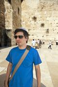 tourist at the western wall - stock photo